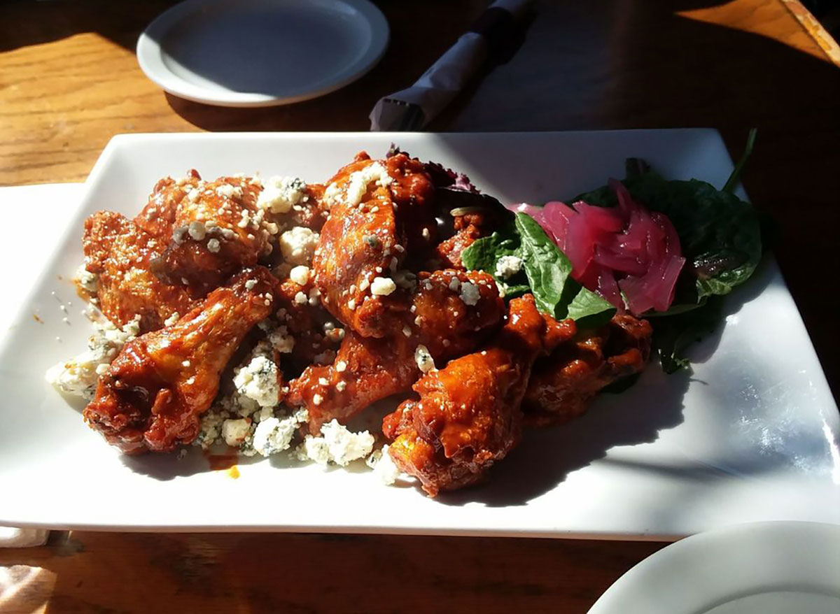plated chicken wings with blue cheese crumbles