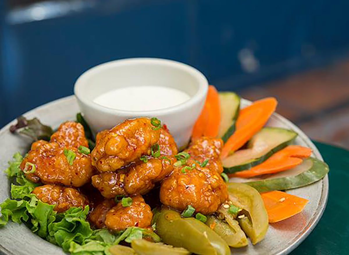 wings with carrots and cucumber slices and ranch dip
