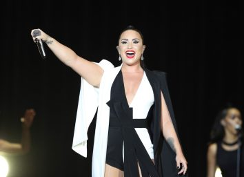 demi lovato performing on stage in black and white outfit