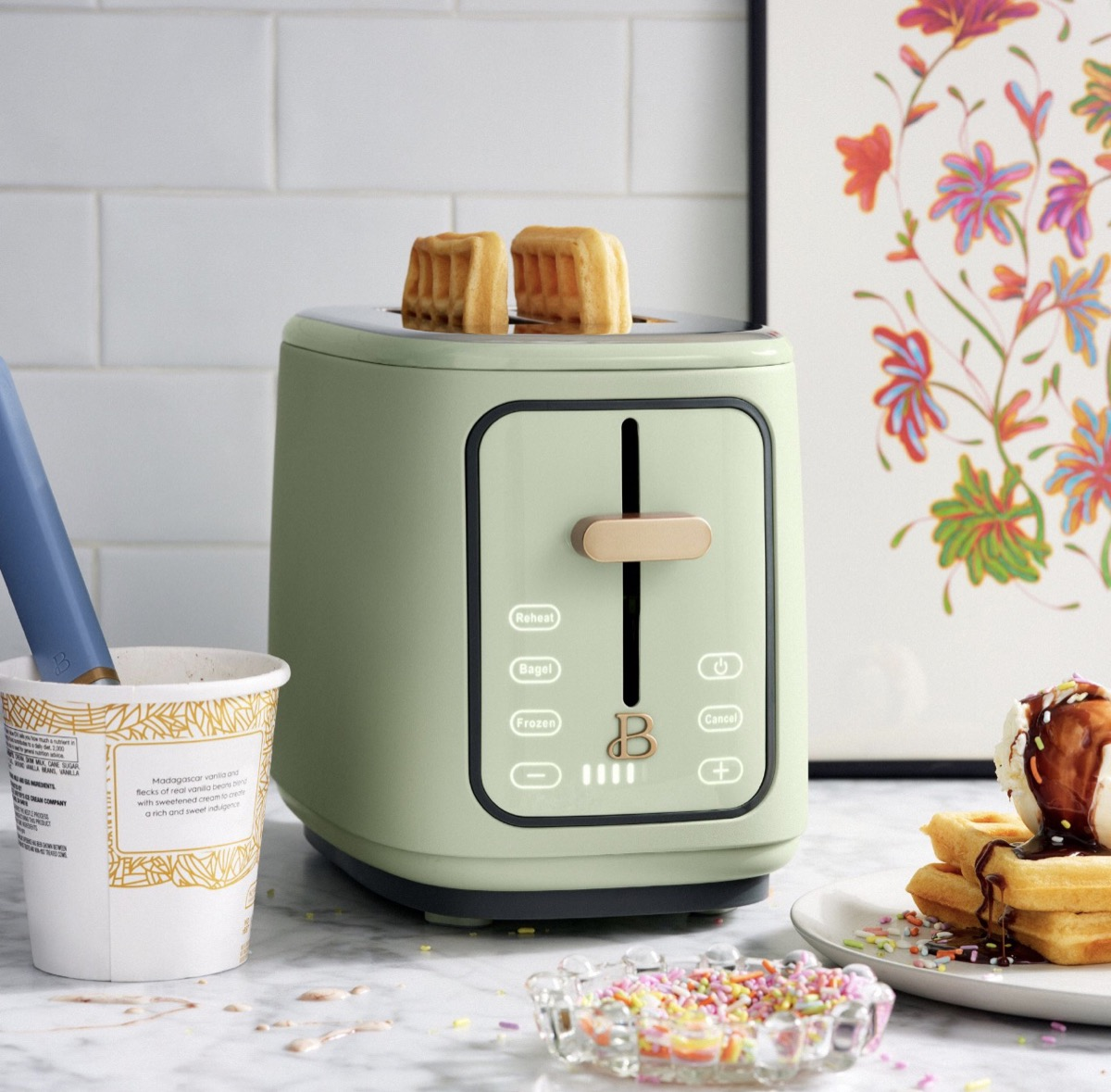 sage green toaster with waffles in it