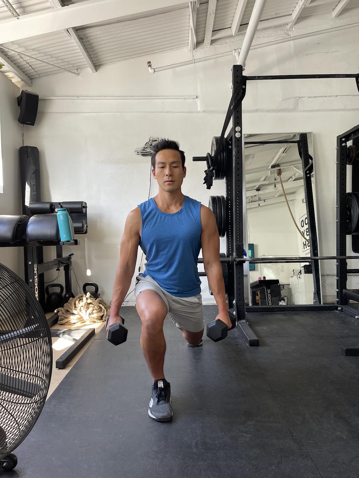 tim liu doing a dumbbell split squat