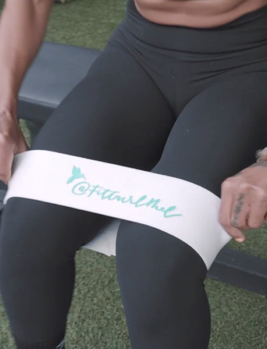 woman in black workout pants and white thigh band