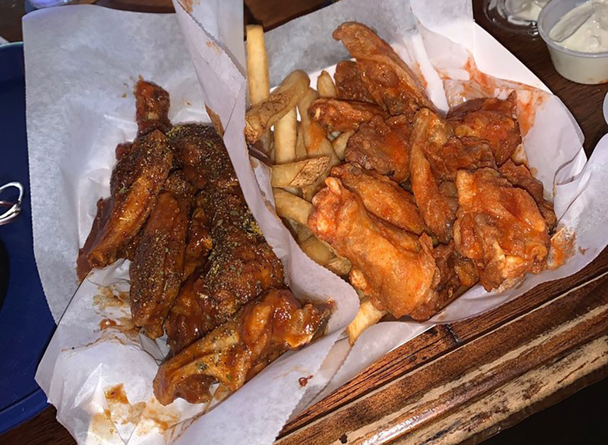 two plates of chicken wings