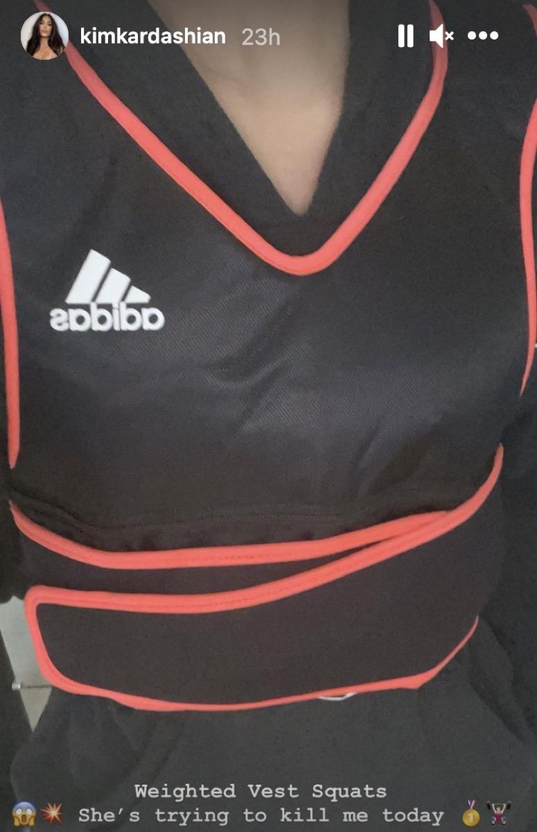 kim kardashian in black workout vest