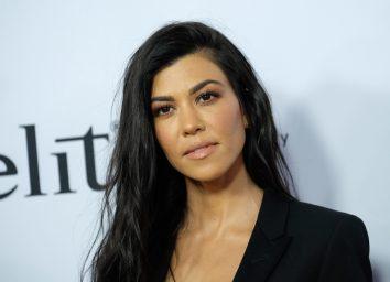 kourtney kardashian in black outfit on red carpet