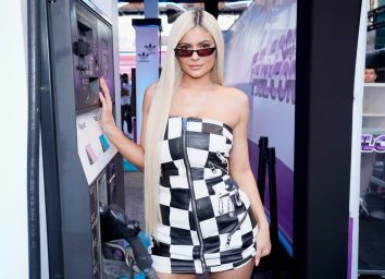 kylie jenner in a black and white dress and sunglasses