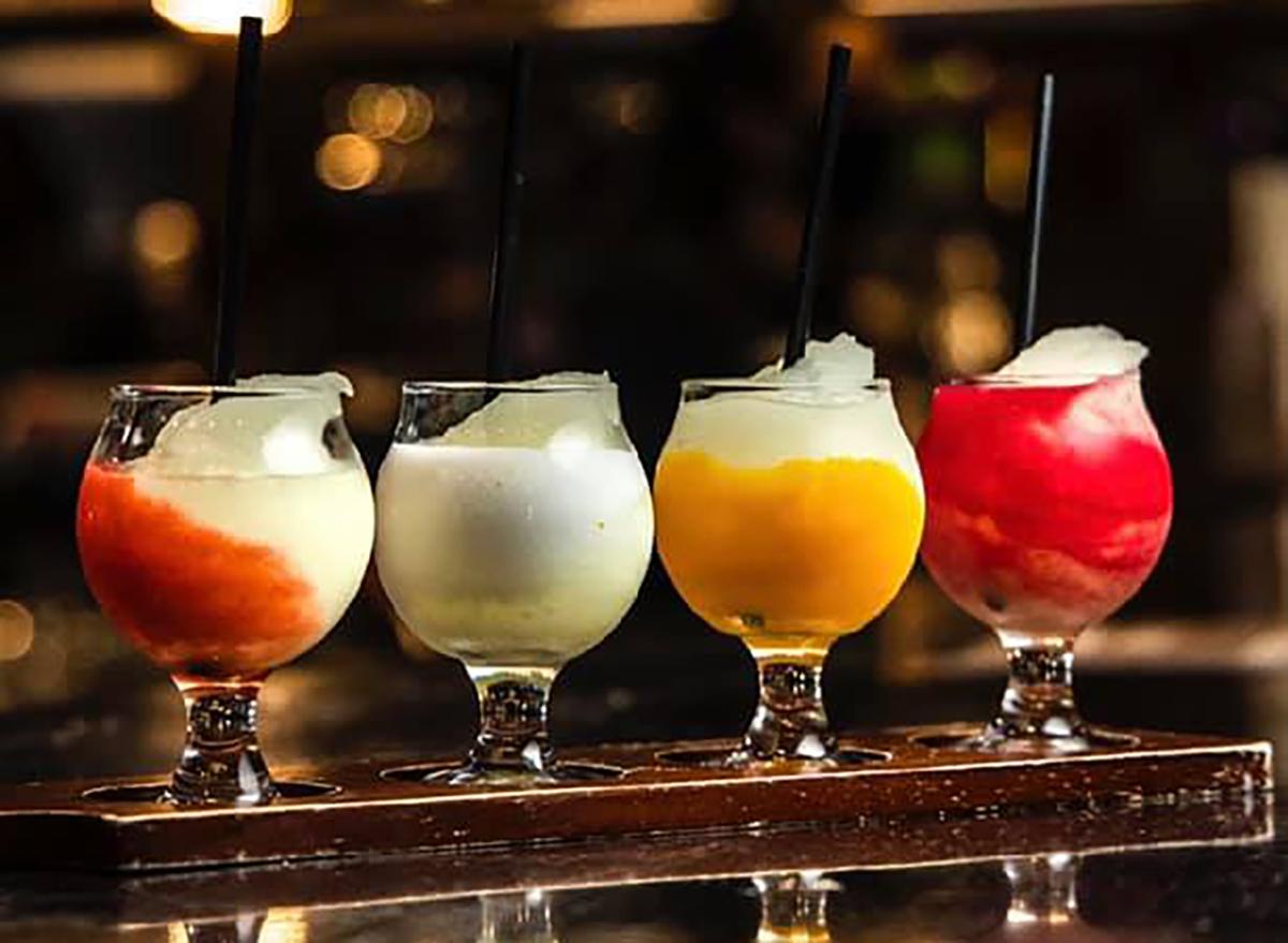 four frozen margaritas on bar