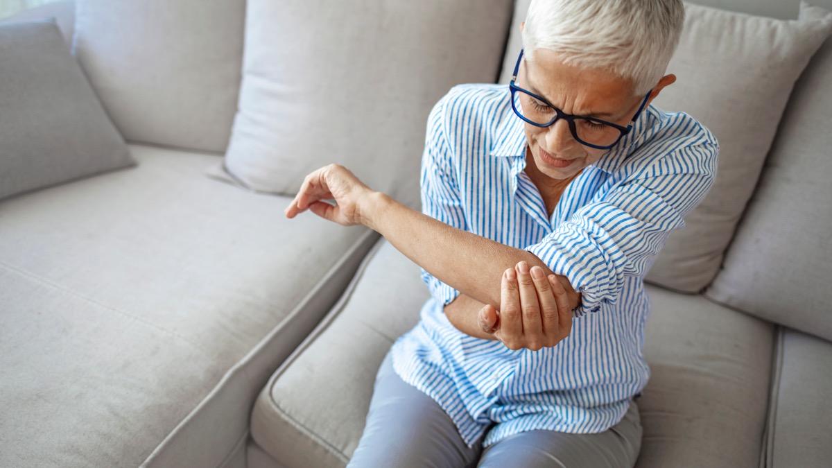 Senior woman with arm pain