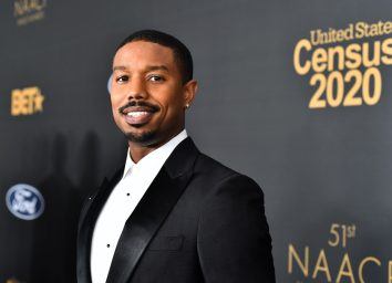 michael b jordan in a suit on the red carpet