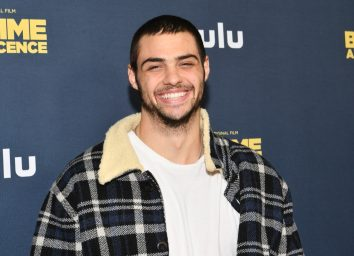 noah centineo in white t-shirt and black plaid sherpa jacket on red carpet