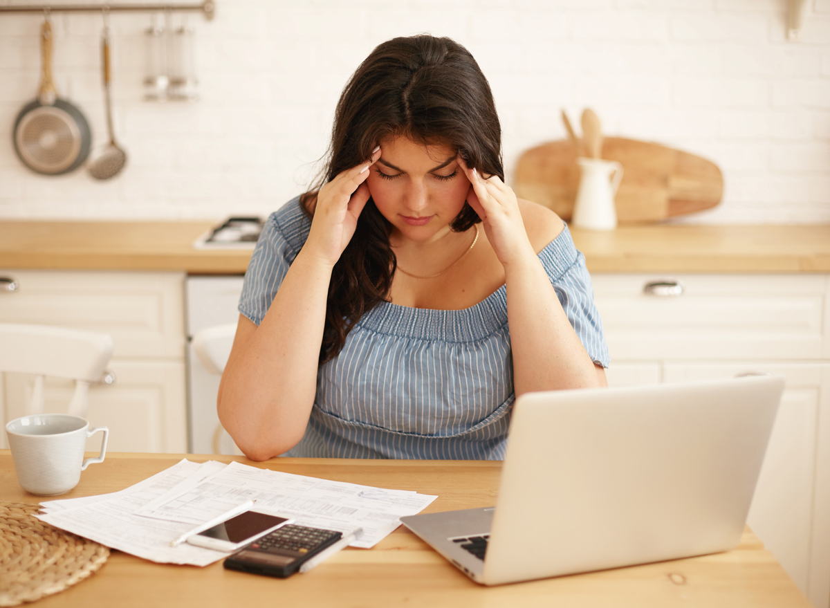 overweight woman stressed with work