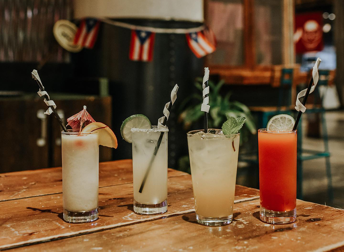 four cocktails on bar