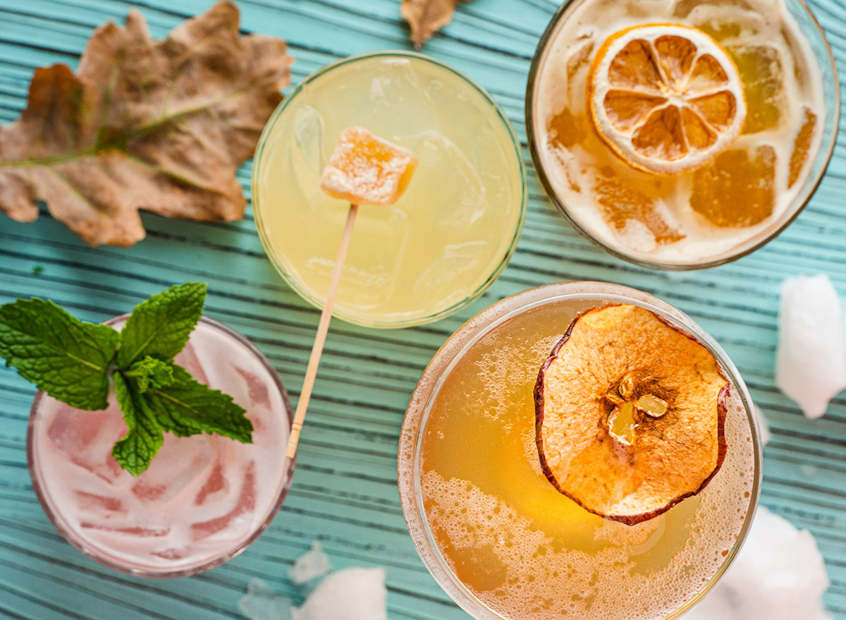 overhead view of colorful cocktails on picnic table