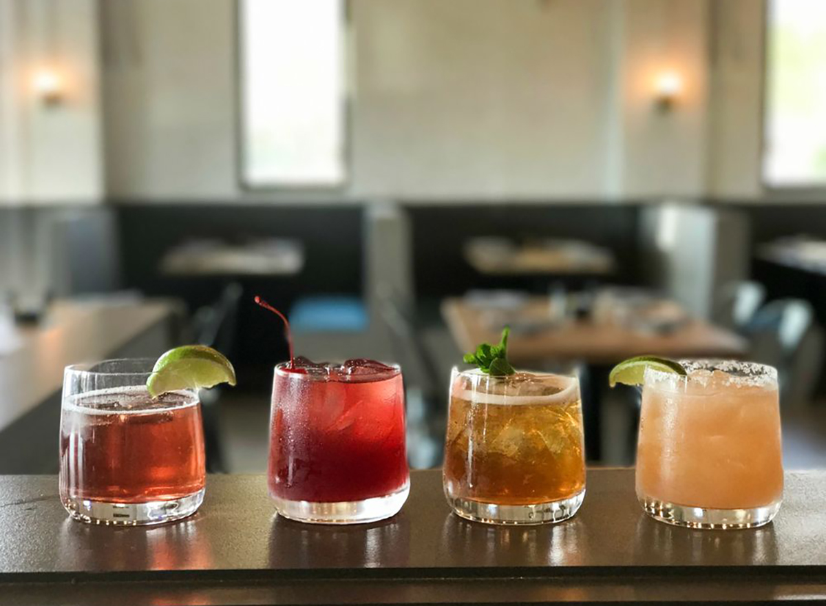row of cocktails from queen park social in charlotte