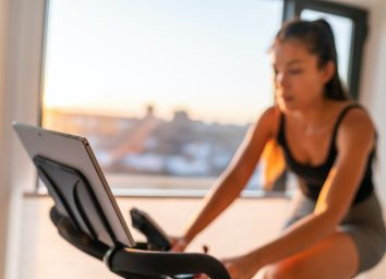 woman at home with an exercise bike