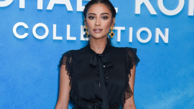 shay mitchell in blue dress on red carpet