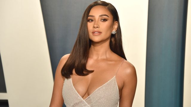 shay mitchell on the red carpet in a silver gown