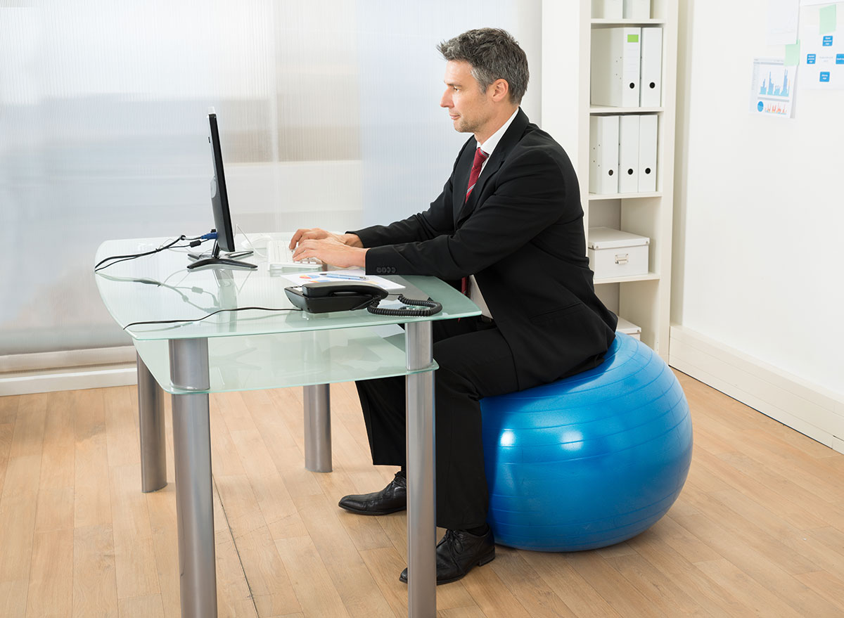 sitting on yoga ball in office