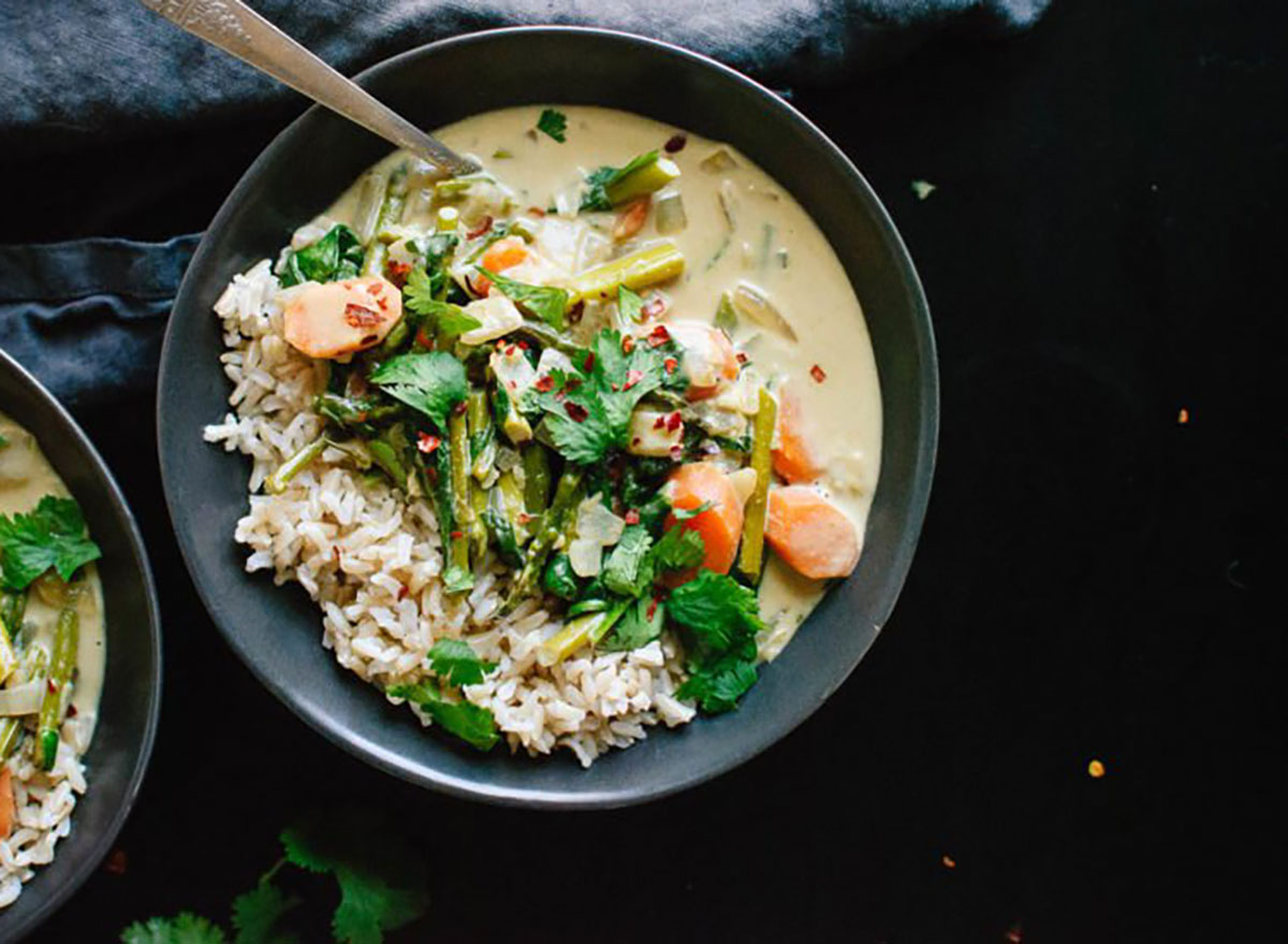 thai green curry in bowl with spoon