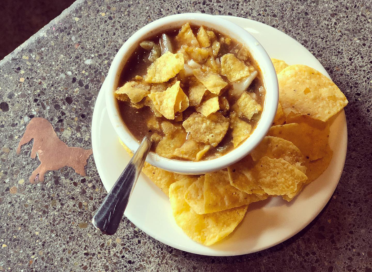 bowl of black bean soup topped with tortilla chips