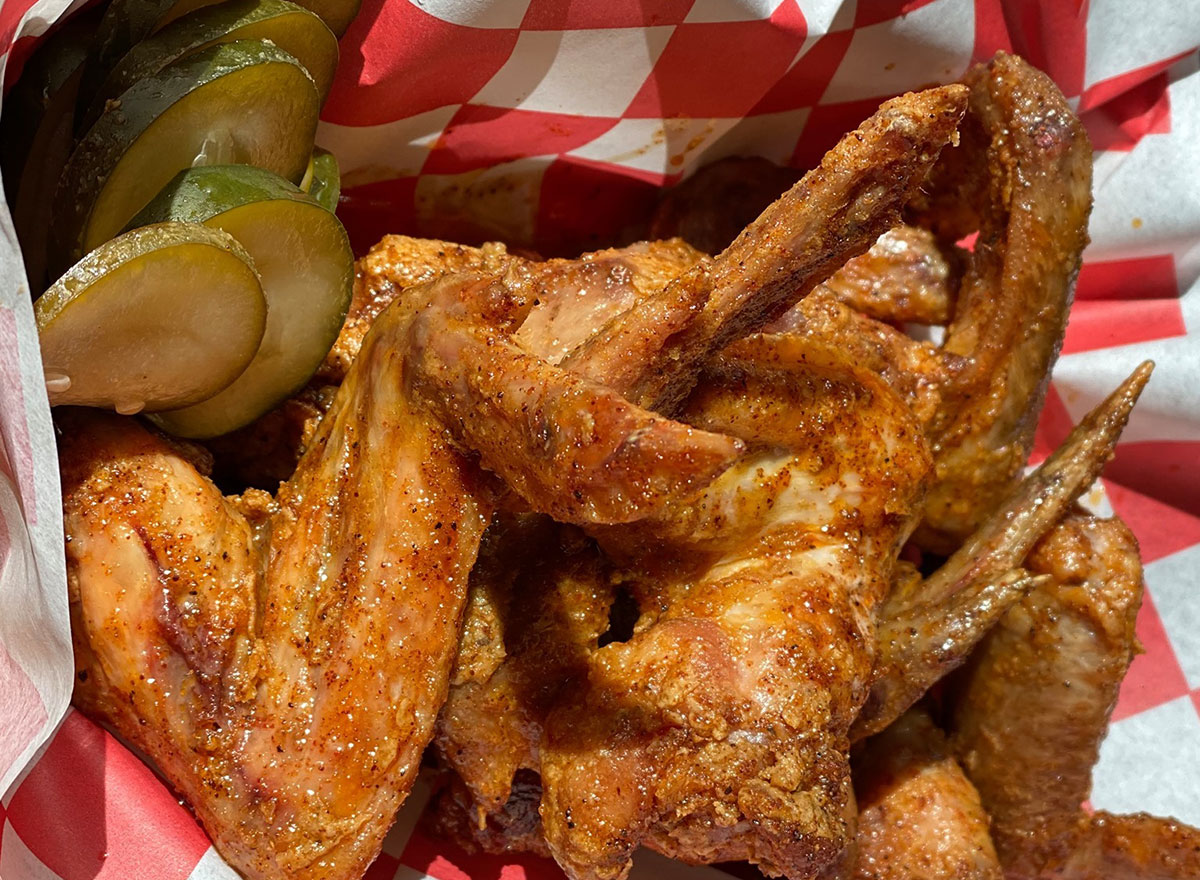 plate of wings with pickles