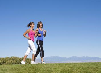 two women walking fast
