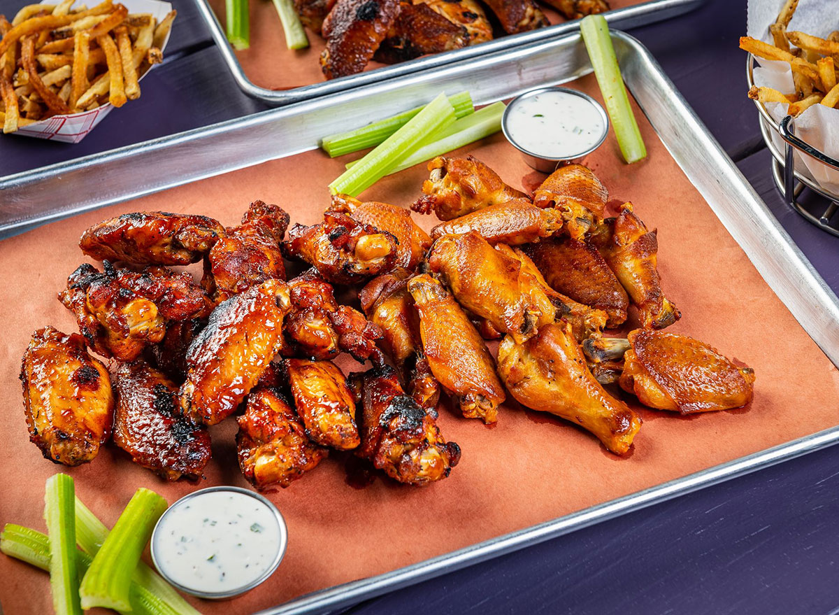 plate of chicken wings with dip