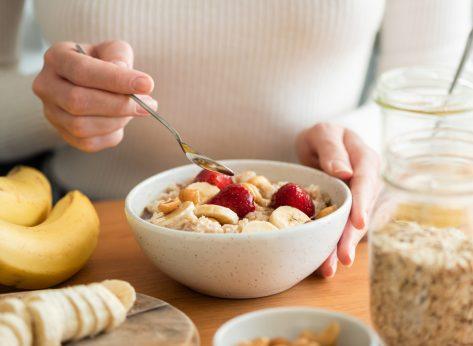 woman eating oatmeal for breakfast