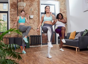 women walking in place at home during a walking workout