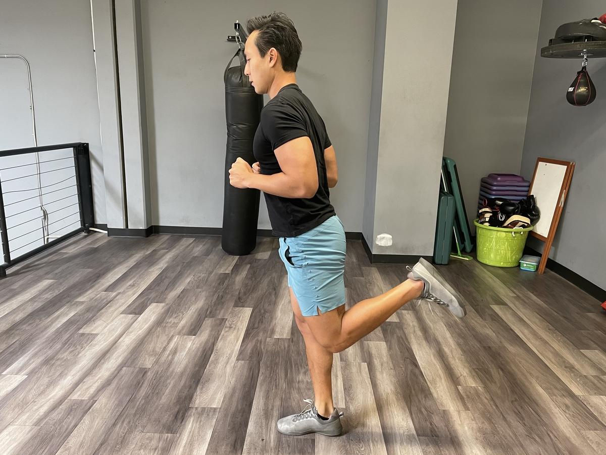 tim liu doing butt kickers