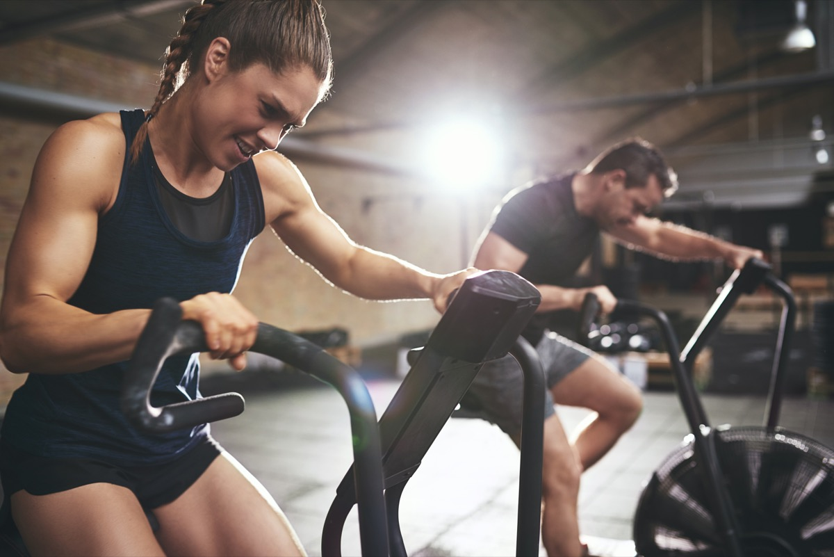 people working on exercise bikes