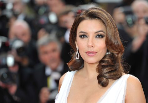 Eva Longoria in White Swimsuit Looks Fit After Trampoline Workout