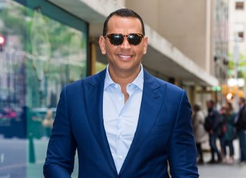 alex rodriguez or a-rod outdoors in blue suit smiling