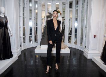 adriana lima in black suit in showroom