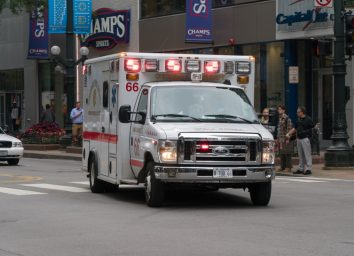 Chicago PD ambulance rushing through downtown intersection towards emergency