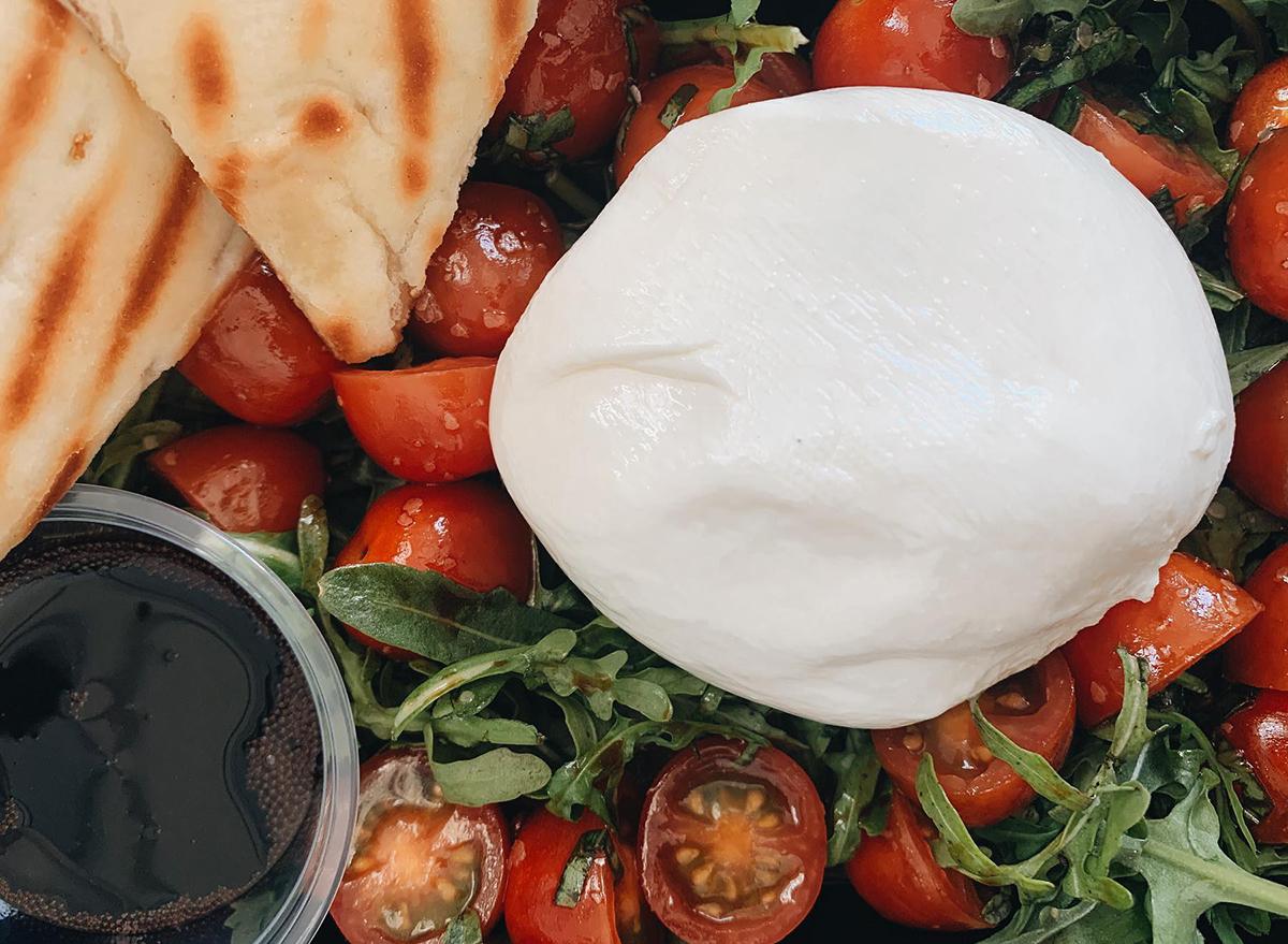 arugula and tomatoes with burrata