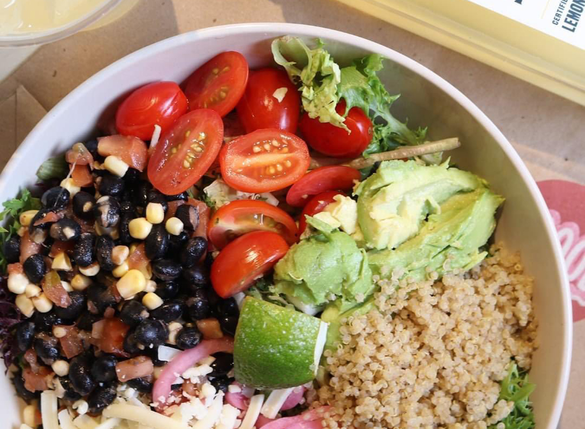 avocado and lime bowl with grains and corn