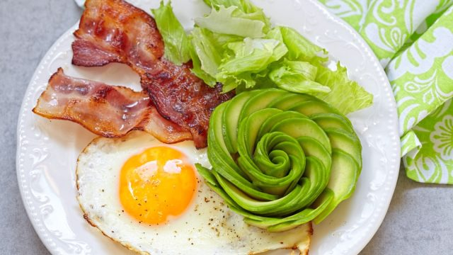 bacon, eggs, and avocado flower on plate