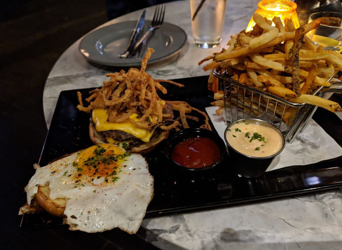 bad wolf burger topped with shoestring fries