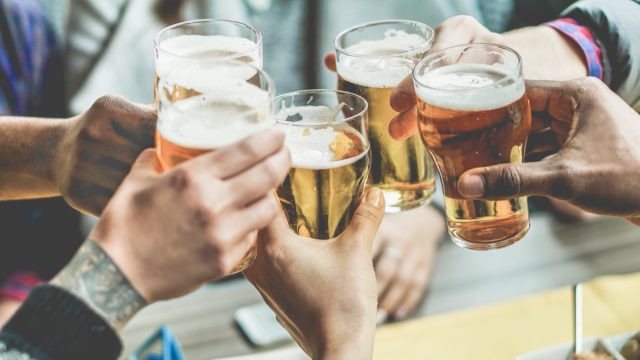 group of friends toasting with glasses of beer