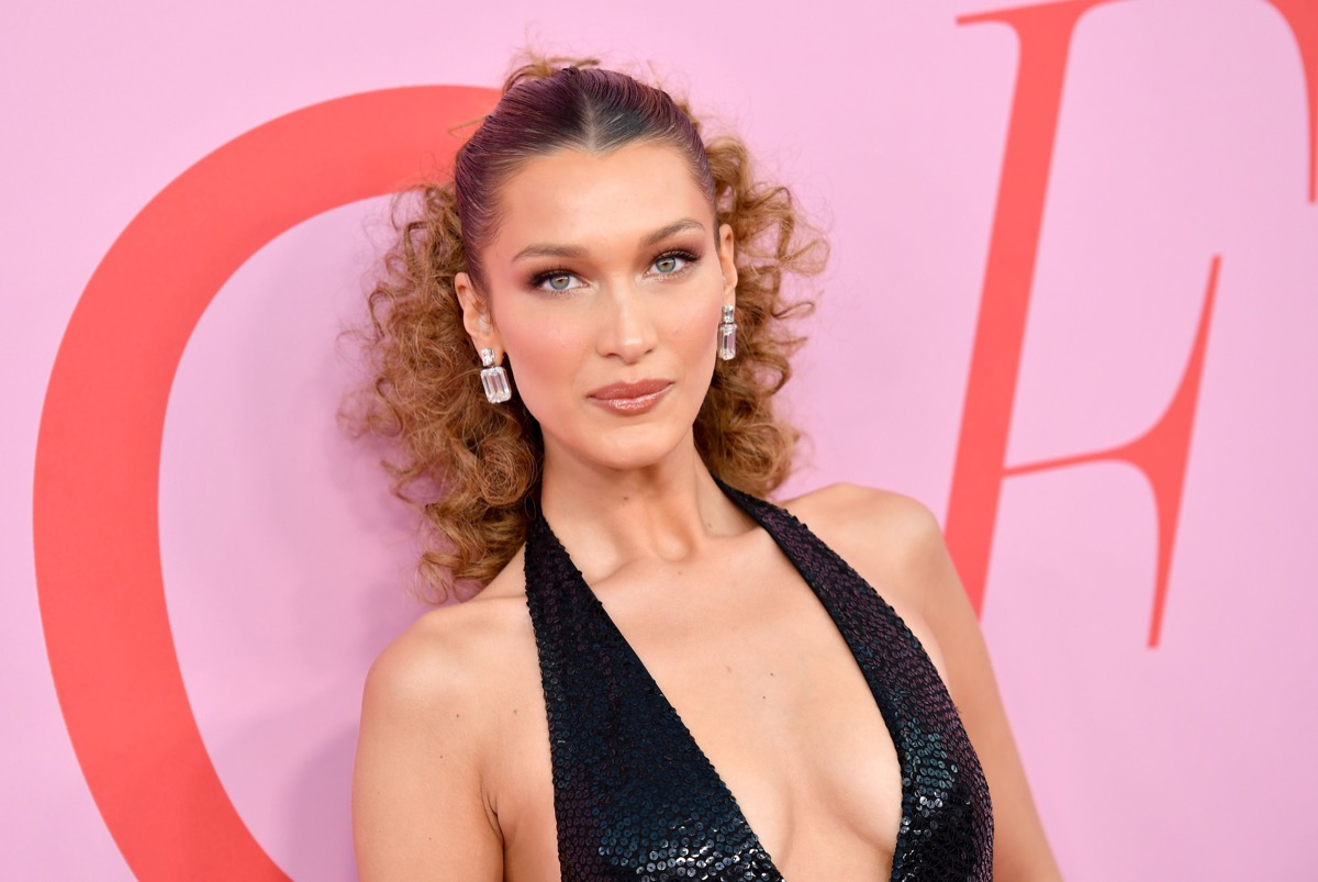 bella hadid in black dress with curly hair on red carpet