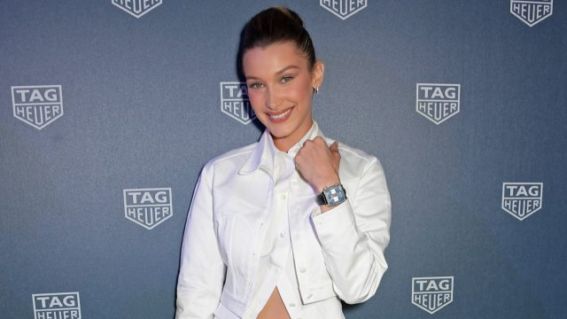 bella hadid in white midriff bearing outfit on red carpet