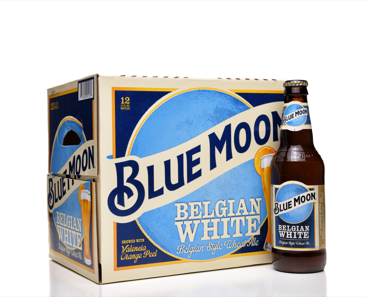 blue moon belgian white beer box with a bottle of beer in front of it