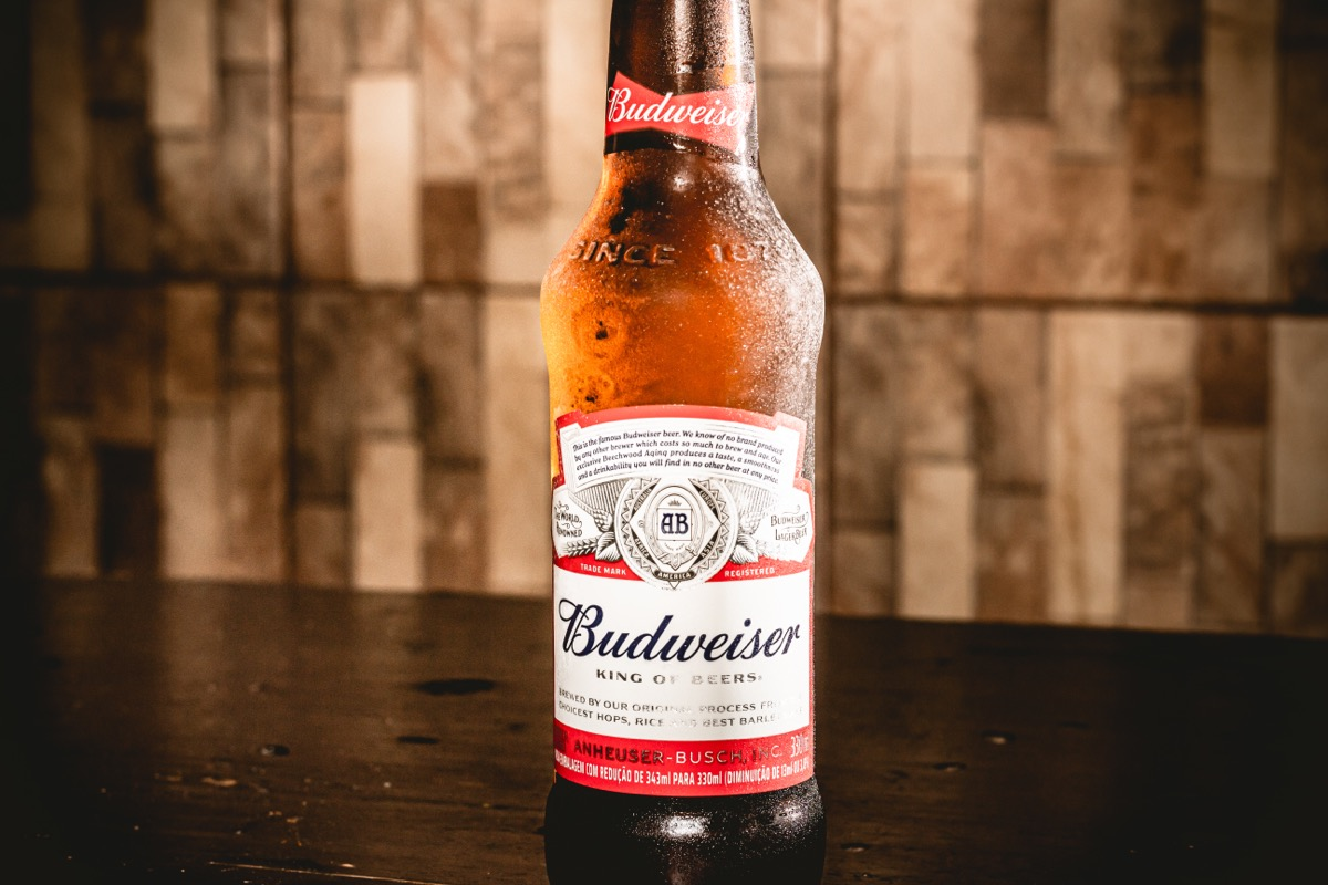 budweiser beer in a bottle on a table