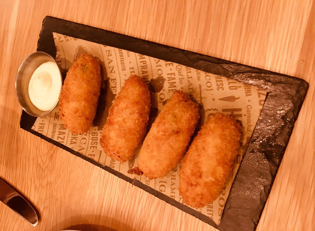 plate of chicken croquettes with dipping sauce
