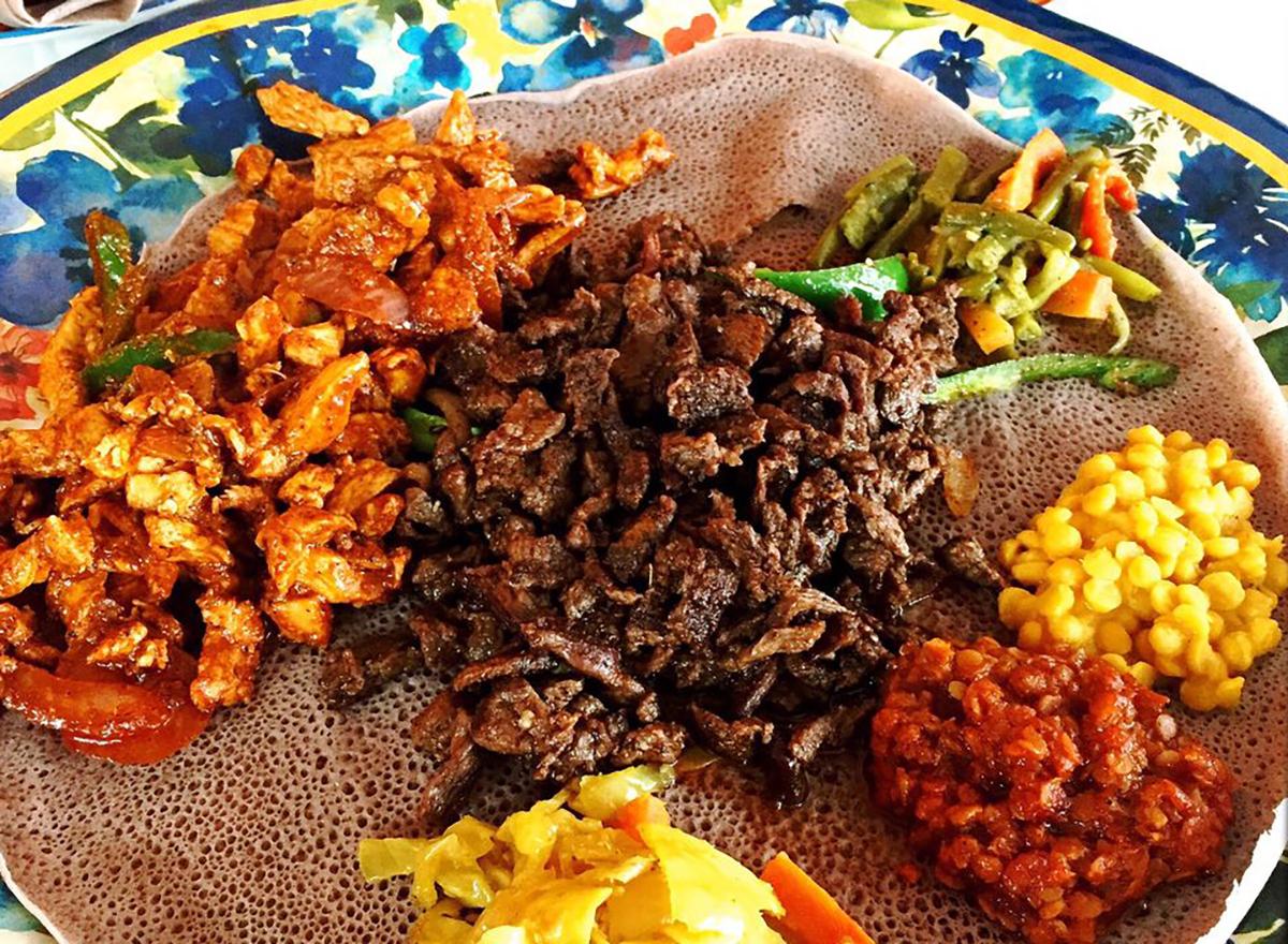 chicken tibs on plate