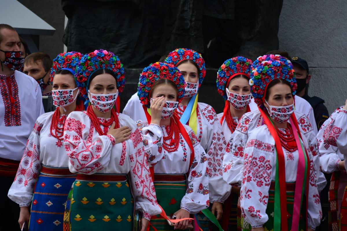 Members of a choir singing in face masks.