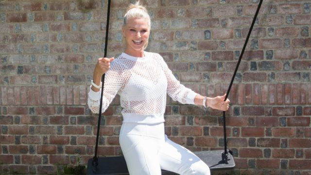 christie brinkley in white outfit on swing