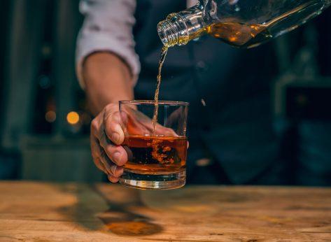 drinking whiskey
