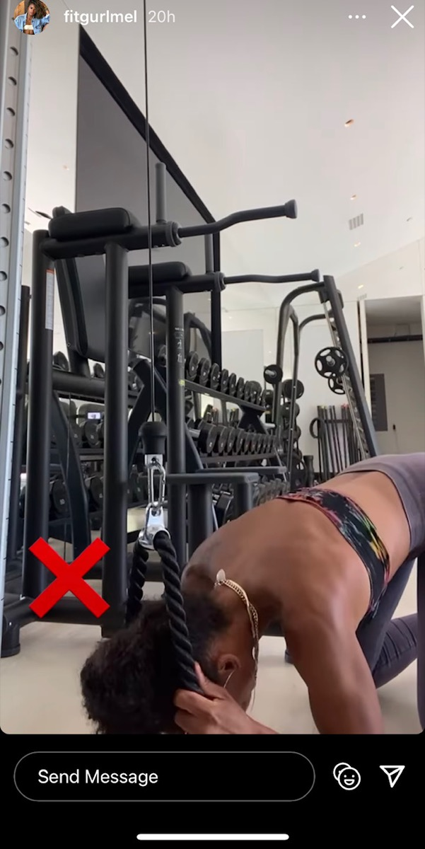melissa alcantara in bandeau top and gray pants doing a cable crunch ab workout and putting her elbows on the floor